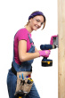 woman-construction-carpenter-installing-electrical-box-power-drill-on-white